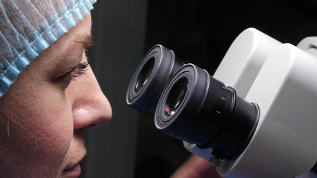 Researcher using her microscope