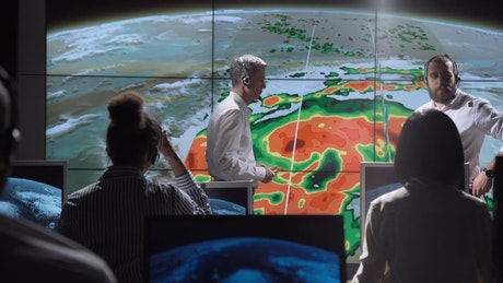 Researchers tracking hurricane on the monitor