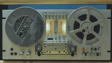 Retro audio tape recorder in motion
