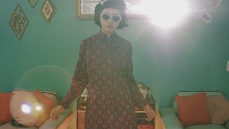 Retro woman with sunglasses dancing