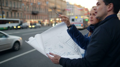 Reviewing building plans in the street