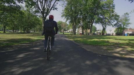 Riding a bike through a city park