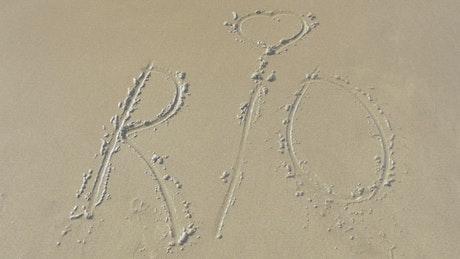 Rio written in the sand