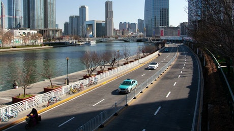 River and avenues in a sunny city