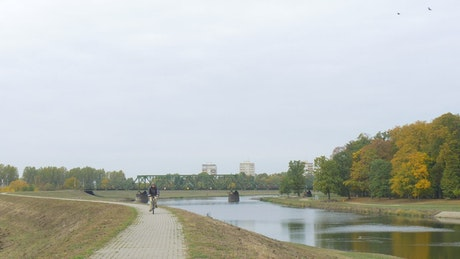 River in a large park with people and trees