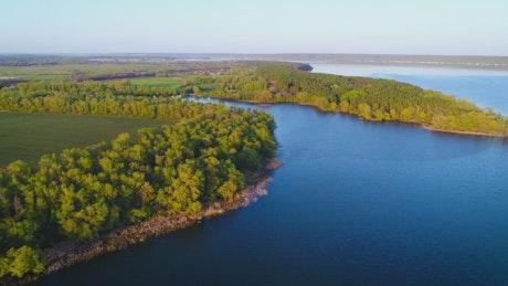 River near farm fields, aerial shot