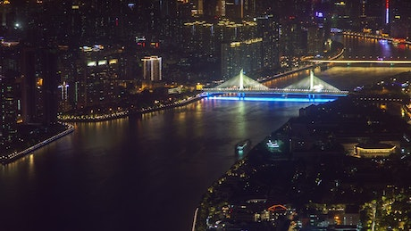 River that crosses a vast city at night
