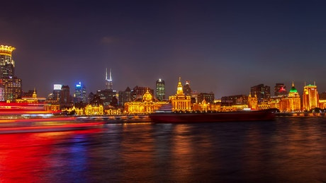 River traffic and the city lights in the night