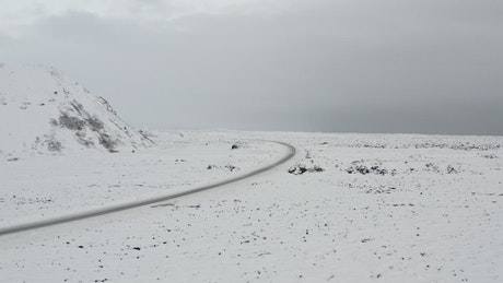 Road crossing a snowy landscape