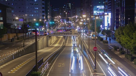 Roads of a large metropolis with cars at night