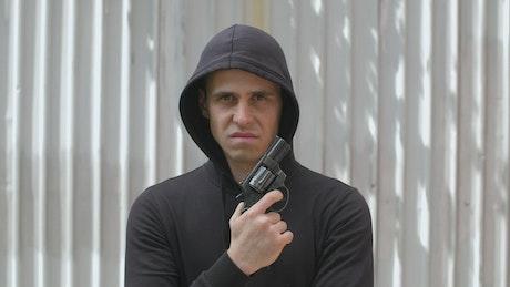 Robber holding a gun, portrait
