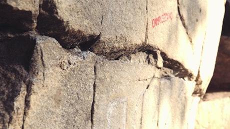 Rock climber climbing a rock in the sun