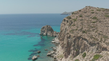 Rocky sea shore with turquoise blue ocean