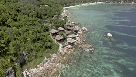 Rocky seashore with bungalows