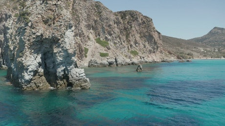 Rocky shoreline with a turquoise blue sea
