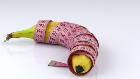 Rolled banana with measuring tape