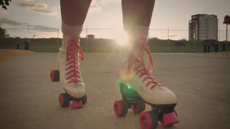 Roller skates of a girl when skating down an empty street