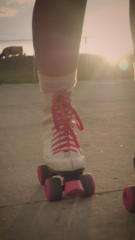 Roller skates of a girl when skating on the street