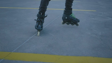 Rolling skates through a parking lot