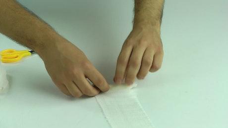 Rolling up a bandage