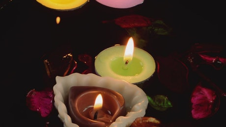 Romantic candles floating in water