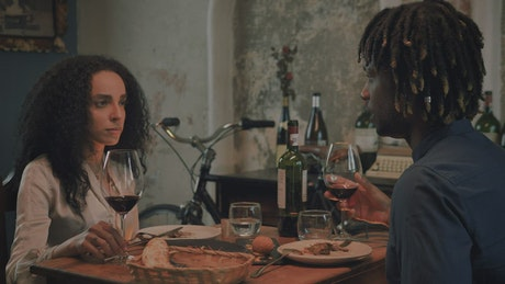 Romantic dinner of a boy and a girl with wine