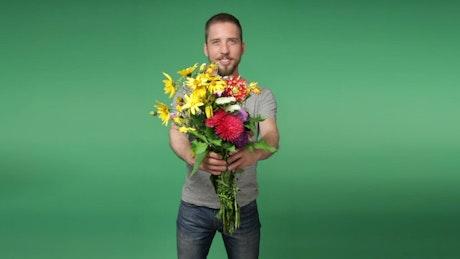 Romantic man holding flowers