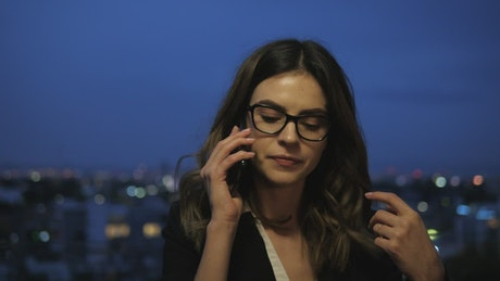Rooftop phone call by businesswoman
