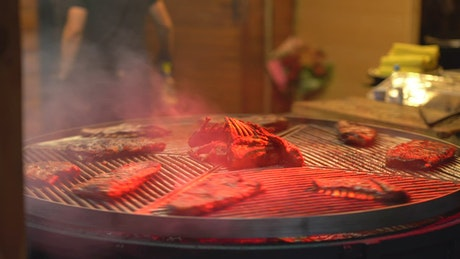 Rotating grill with ribs