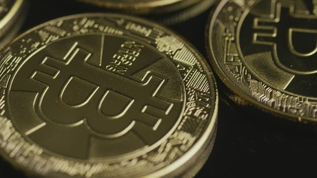 Rotating shot of bitcoins on a black surface