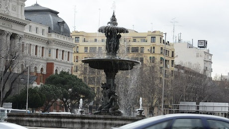 Roundabout fountain with traffic in Europe