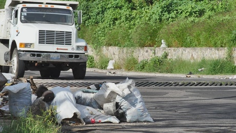 Rubbish piled up on a street sidewalk