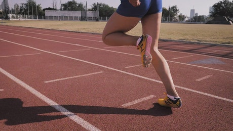 Runner on a track in slow motion