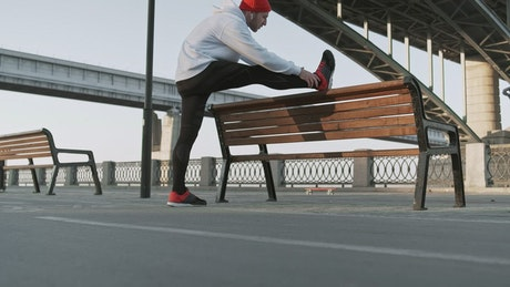 Runner stretching his body before start running