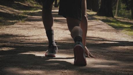 Runner training in a park
