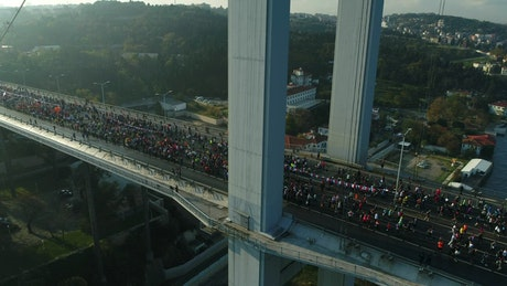 Runners heading over a bridge in Istanbul