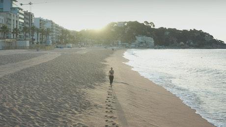 Running along a town beach
