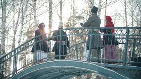 Russian folklore people dancing on a bridge