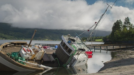 Rusty sailing ship sinking