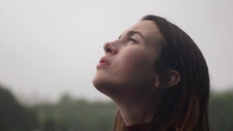 Sad woman looking towards the sky