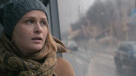 Sad woman taking a bus journey