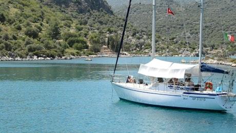 Sailboat anchored in a small bay