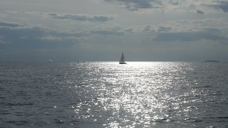 Sailboat heading over a calm sea