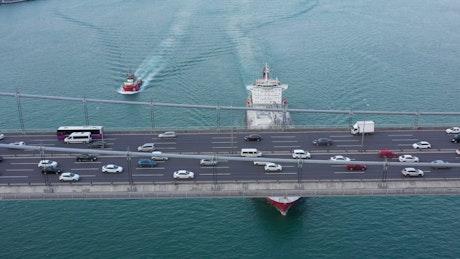 Sailing below a busy bridge
