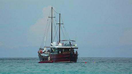 Sailing boat in the middle of the ocean