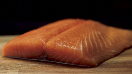 Salmon fillet on a chopping board