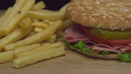 Sandwich with ham and fries
