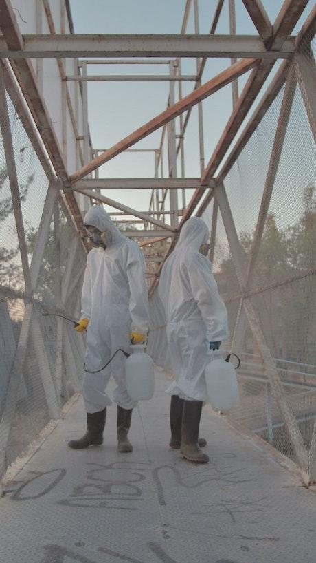 Sanitizers on a pedestrian bridge