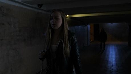 Scared woman walking at night
