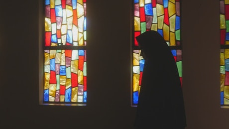 Scary ghost nun walking in a dark church